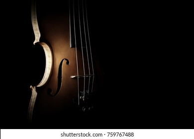 Violin orchestra musical instruments. Silhouette string closeup on black