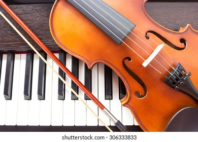 Violin and piano keyboard. Music background. Top view.