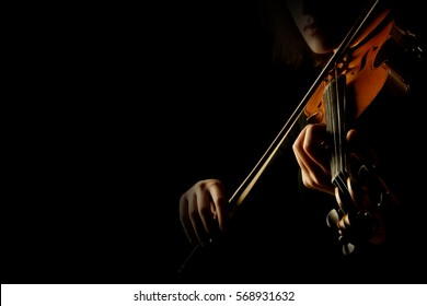 Violin player hands. Violinist playing violin isolated on black. Close up of musical instruments - Shutterstock ID 568931632