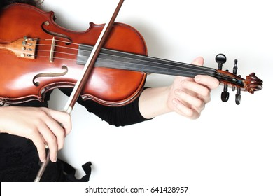 Violin player hands. Violinist playing violin close up