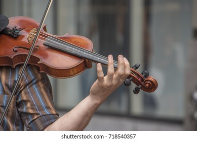 Violin player hands. Violinist playing violin Close up of musical instruments
