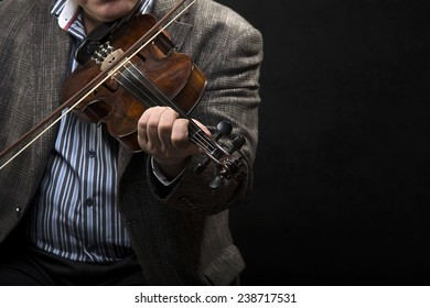 Violin player over black background with space for your text.