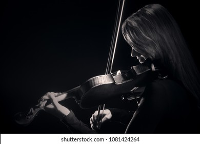 Violin player. Violinist classical musician playing violin music instrument.