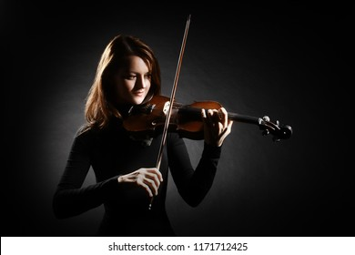 Violin player. Violinist classical musician woman playing violin musical instrument