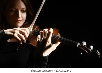 Violin player. Violinist classical musician playing violin orchestra music instrument closeup