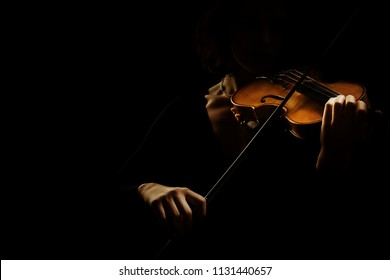 Violin player violinist hands. Orchestra music instrument isolated on black