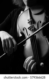 Violin player violinist hands playing musical instrument close up