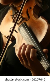 Violin player violinist musical instrument orchestra symphony. Classical music violin close up strings