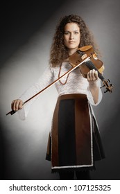 Violin player violinist playing classical music. Orchestra instruments