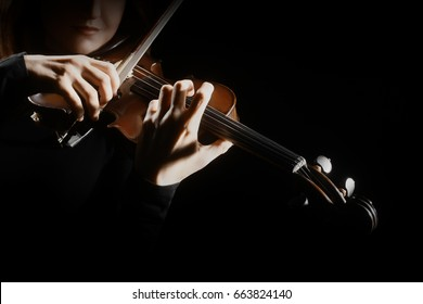 Violin player. Violinist playing violin hands close up music instrument
