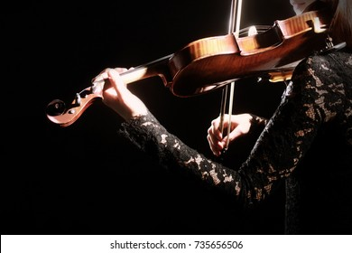 Violin player. Violinist playing violin Hands with musical instrument close up