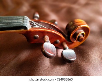 violin scroll on brown cloth