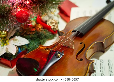 violin and sheet music with Christmas tree 3.