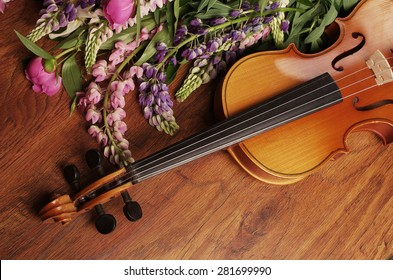 Violin and summer flowers.
