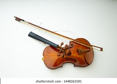The violin that is kept for a long time is broken. White background