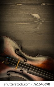 Violin in vintage style on wood background with copy space