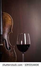 Violin waist detail with glass of red wine