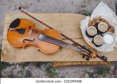 Violin with watter cups