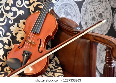 The violin which was put on the sofa of the room