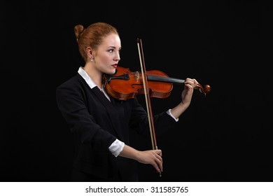 Violinist Playing Classical Violin Music in Musical Performance
