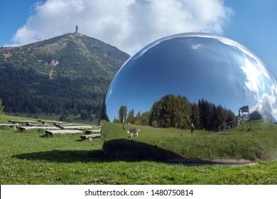 Viote del Monte Bondone, Trentino, Italy - Sept 21 2018 - Mirror like semi sphere of Astronomical observatory Terrazza delle Stelle  with Monte Bondone in the background.