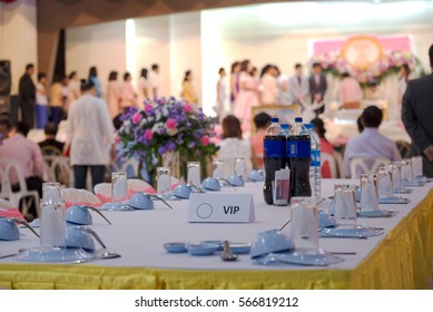 VIP dining table in wedding ceremony, party for importance guest while people are witness to wedding couple, groom, bride