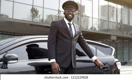 Vip passenger taxi driver politely opening car door for his client, best service