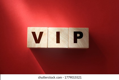 VIP Very Important Person text on wooden cubes on red. Business concept.