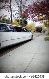 VIP or Wedding Limo arriving at the Sidewalk