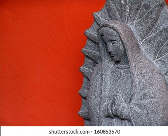 Virgen de Guadalupe carved in stone