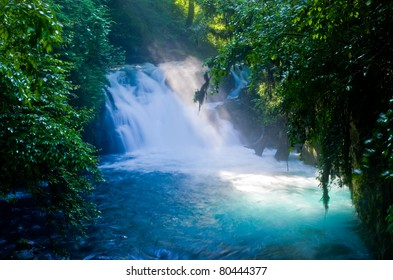 Virgin forest and waterfall , shaft beam of light