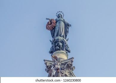 Virgin Mary Statue Immaculate Conception Column Colonna dell Immocolata Rome Italy. 1854 Pope declares Virgin Mary without sin. Column created 1857 Pope puts flower on statue for Christmas.