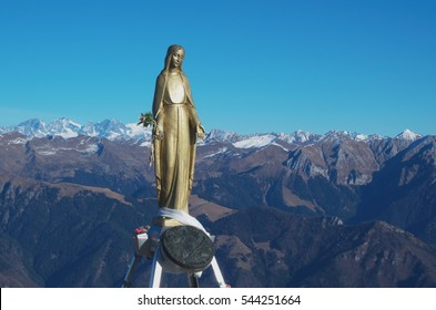 Virgin Mary statue on the top of the mountain. Virgin Mary statue, located on the top of mount Pizzo Baciamorti, Lombardy, Italy.
