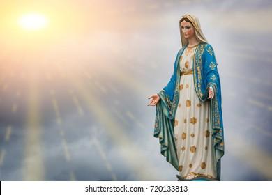 Virgin Mary statue and sunset at the Catholic Church Chanthaburi province, Thailand.