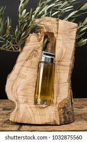 Virgin olive oil glass jar in an olive tree trunk.