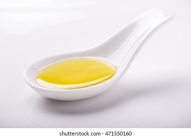 virgin olive oil in a porcelain spoon