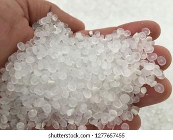 Virgin Plastic Pellets with hand