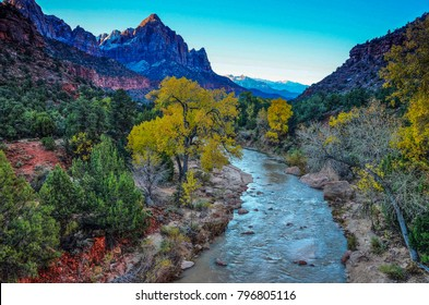 The Virgin River flows west from its source in Navajo Lake.  It winds through Zions National Park and slowly, through erosion, forms the deep canyon of Zions. The Watchman Mtn. is in the background.
