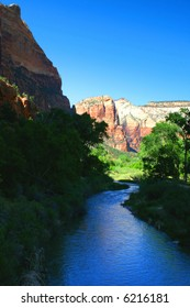 the Virgin River passing by a cliff in Zion National Park, Utah