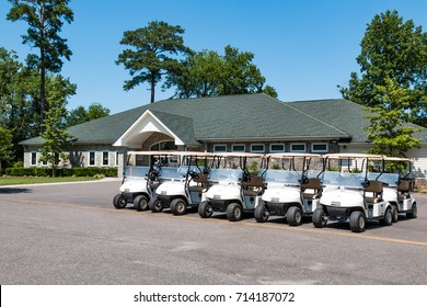 VIRGINIA BEACH, VIRGINIA - JULY 10, 2017:  A row of golf carts near the Clubhouse/Pro Shop at the Stumpy Lake golf course, an 18-hole course hidden by a forest and near a popular recreational lake.