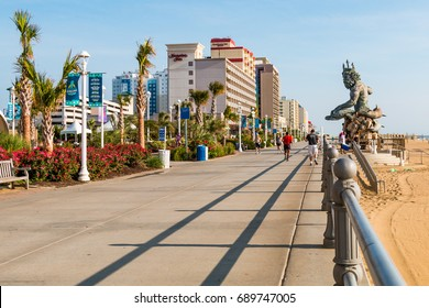 VIRGINIA BEACH, VIRGINIA - JULY 13, 2017:  The oceanfront boardwalk and resort area along the Atlantic coast, which features a 34-foot tall statue of King Neptune.
