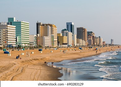 VIRGINIA BEACH, VIRGINIA - JULY 13, 2017:  Dawn lights the oceanfront high-rise hotels lining the boardwalk at this popular tourist destination.