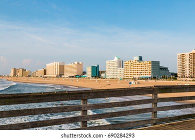 VIRGINIA BEACH, VIRGINIA - JULY 13, 2017:  Hotels line the oceanfront at daybreak, as seen from the fishing pier on the boardwalk of this popular tourist destination.