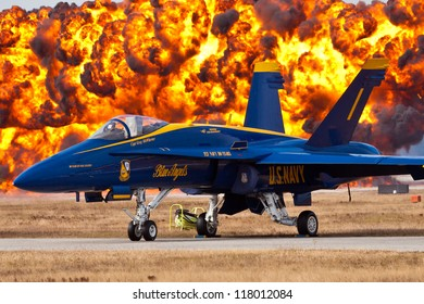 VIRGINIA BEACH - MAY 15:f-18  Blue Angels #1 with wall of fire in the background in Virginia Beach on May 15,2012 #1 plane is flown by the commander team is oldest demonstration group in the world