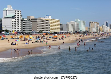 Virginia Beach, Virginia USA: June 2, 2018:  On a beautiful summer day tourist who visit the resort city of Virginia Beach have fun  in the water and on the sand.
