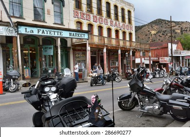 VIRGINIA CITY, NV JUNE 6, 2015: Motorcycles park along the street amid old western buildings during the seventh annual public Street Vibrations Spring Rally in Virginia City, Nevada on June 6, 2015.