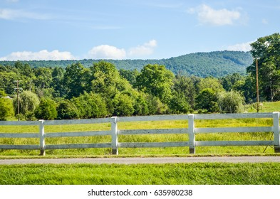 Virginia countryside in summer with fence and farms