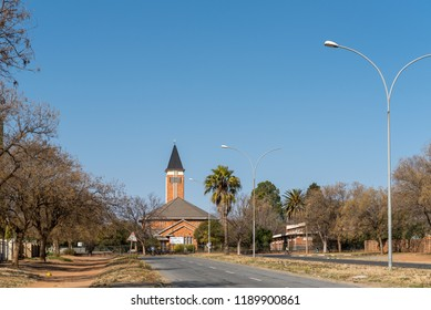 VIRGINIA, SOUTH AFRICA, AUGUST 2, 2018: The Dutch Reformed Church in Virginia in the Free State Province Province. Trees and lamp posts are visible