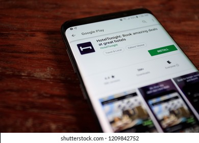 Virginia, USA - October 23, 2018: HotelTonight - Book amazing deals at great hotels Android app on smartphone screen close-up wood background.