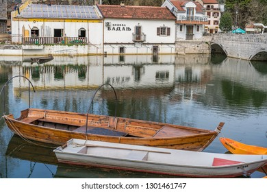 Virpazar, Montenegro - April 2018 : Neglected empty fisherman boats on the shore of lake Skadar